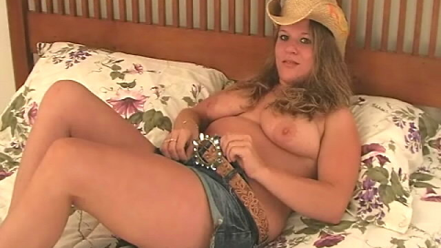 hottie-blonde-cowgirl-christy-stripping-and-showing-her-large-tits-in-bedroom_01
