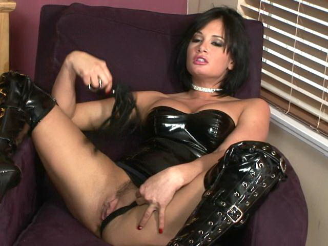 Hottie brunette pornstar in big latex boots Tory Lane fingering her shaved beaver on the couch