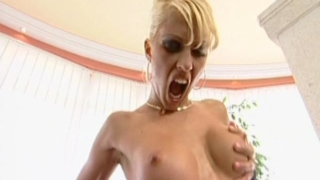 Huge boobed blonde harlot riding a monster shaft like crazy