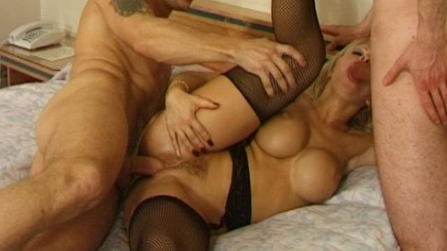 huge-breasted-blonde-whore-in-stockings-gets-fucked-by-two-hunks_01