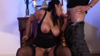 Huge meloned brunette slut in stockings sucking a massive pecker