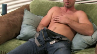 Incendiary blonde gay Johnny rubbing his giant shaft on the couch