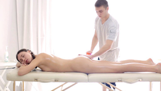 Innocent Lesya gets bent over on the massage therapists table and fucked.