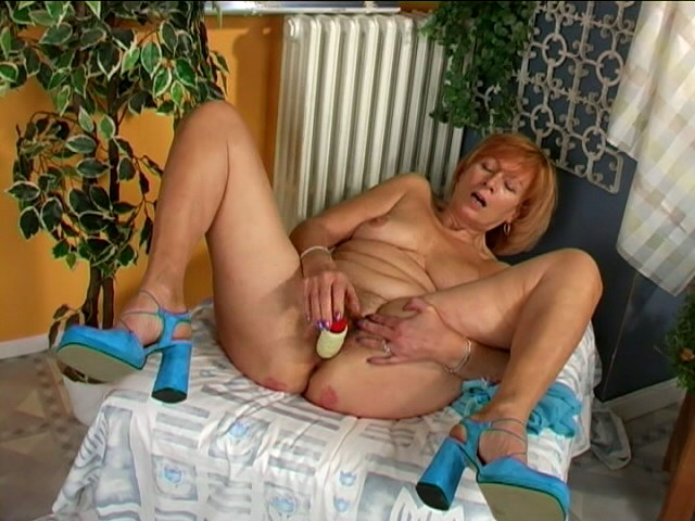 Irresistible redhead granny Lady masturbating her wet beaver Is That Grandma XXX Porn Tube Video Image