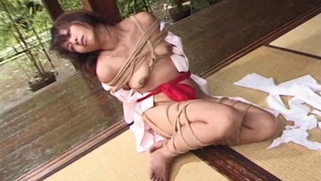 japanese-held-in-rope-bondage-outdoors-by-dom_01