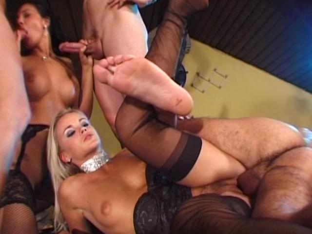 Lecherous lesbians in stockings eating two dicks in a gangbang
