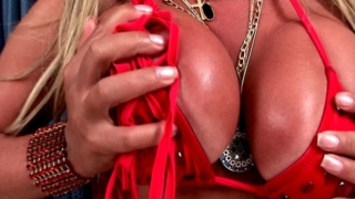 Long haired blonde shemale bitch Dayanne showing giant knockers and fuckable bubble butt