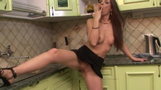 Long haired brunette wife spreads long legs and rubs pussy in the kitchen