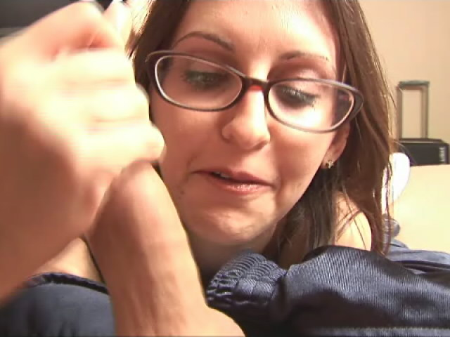 Long haired geeky girl in glasses Nikki massaging a monster prick in bedroom