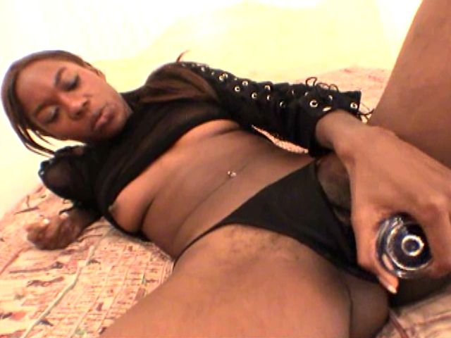Lovely young black girlfriend Aisha Anderson playing with a large glass dildo