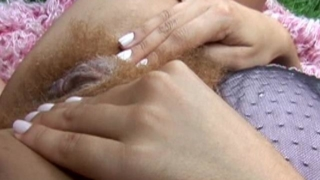 Luciane plays with her hairy pussy in the garden before her boyfriend fucks her