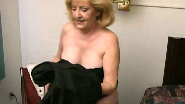 lustful-blonde-grandma-kitty-fox-stripping-and-showing-her-sexy-decolletage_01