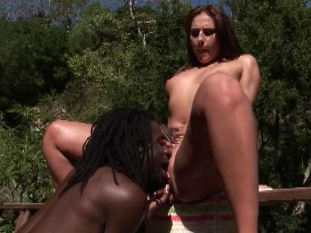 Lustful brunette pornstar Lauren Phoenix gets pink twat licked by a black stud outdoors