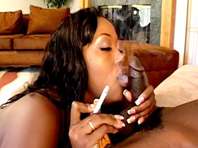 Lustful chocolate goddess Aryana Starr smoking and sucking a pair of black balls