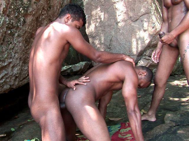 Lustful dark skinned gays Bruno, Junior and Thiago sucking their huge dicks with lust outdoors