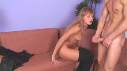 Lustful young female teacher rubs cock of her student.