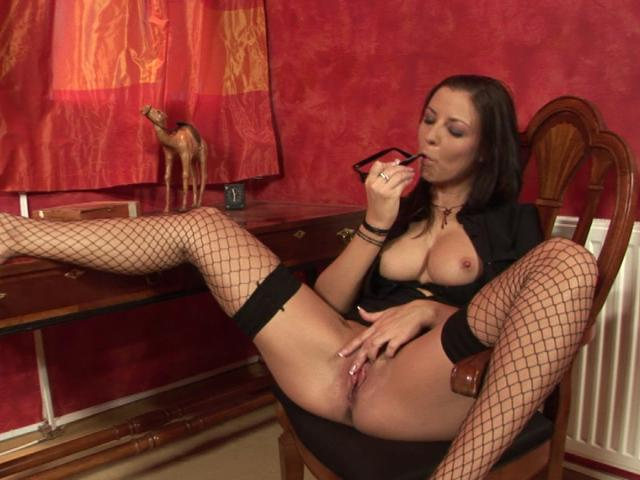 Lusty office babe in fishnets fingering her pink slit on the chair