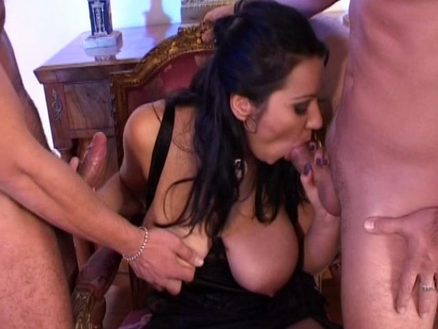 Massive breasted brunette babe sucking two huge cocks Massive Big Tits XXX Porn Tube Video Image