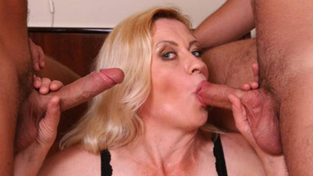 Mature beauty kisses two cocks Matures XXX Porn Tube Video Image