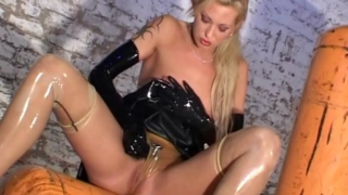 Mistress in rubber panties masturbating her slick beaver
