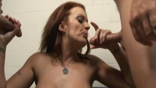 Monica Mayhem Spits On These Two Dicks And Jerks Them Off Until They Cum All Over Her Face