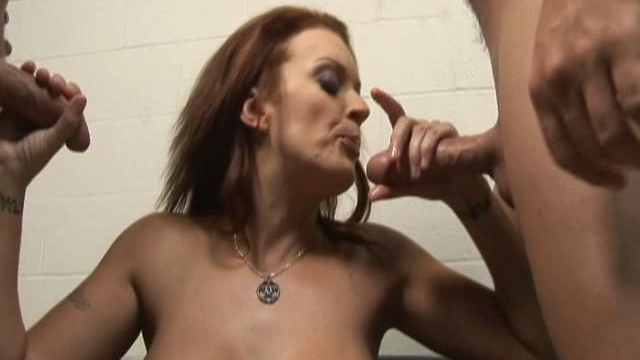 Monica-mayhem-spits-on-these-two-dicks-and-jerks-them-off-until-they-cum-all-over-her-face_01