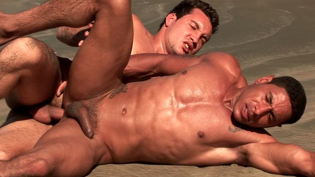 muscle-bodied-bronzed-gay-alber-charles-gets-anally-smashed-from-behind-by-anthony-gimenez-on-the-beach_01