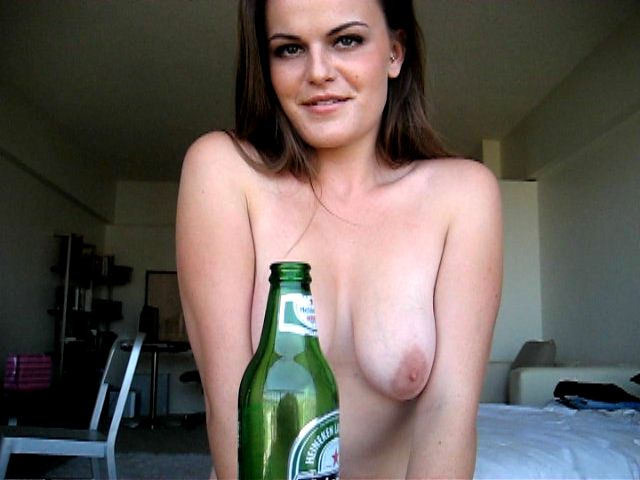 Naked brunette exgirlfriend babe Ariel sucking a beer bottle with lust