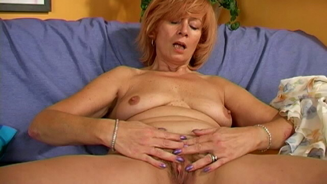 nasty-granny-lady-stripping-panties-and-playing-with-her-hairy-pussy-on-the-couch_01