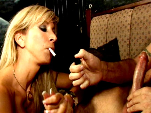 Naughty blonde charmer Morgan Ray smoking with lust and sucking a giant penis