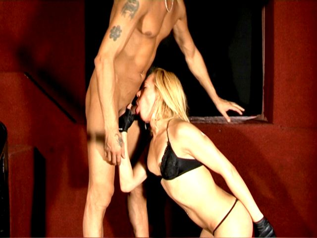 Naughty blonde tranny in black bra Rubia gives blowjob to a bald stud