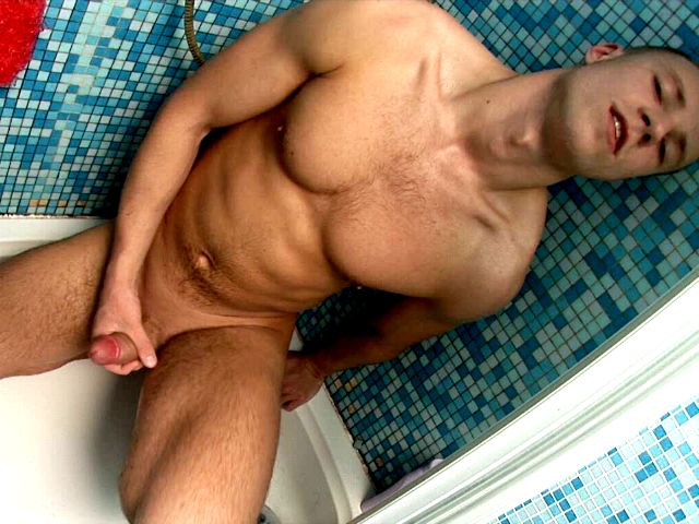 Naughty brunette European twink Ken jerking off his hard shaft in the bathroom