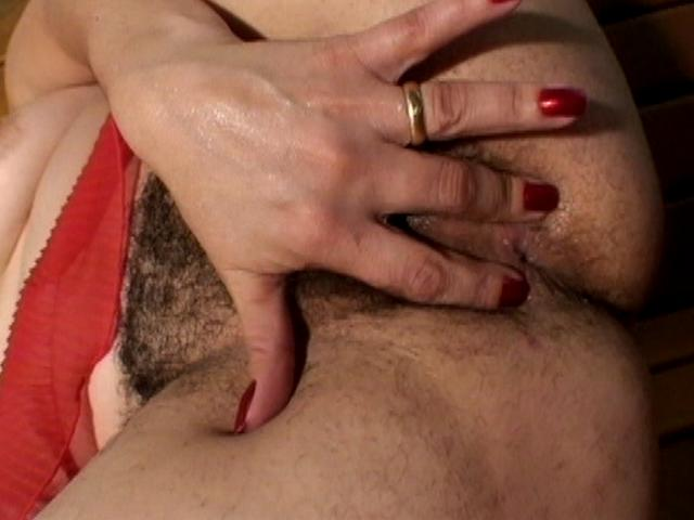 Naughty mature woman Lauritta fingering her hairy muff and getting boned by a black stud