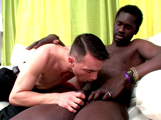 Naughty white gay John kissing black Canu's hot boy on the couch