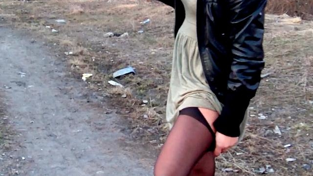 Orgiastic-brunette-wife-dasha-showing-her-booty-upskirt-outdoors_01-1