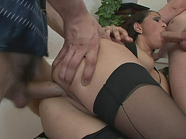 Passionate brunette in stockings gets anally fucked and gives blowjob in a threesome