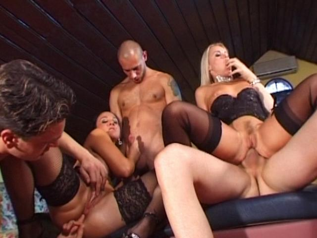 Passionate lesbians in stockings getting banged by three horny hunks