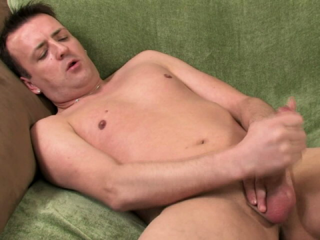 Perverse brunette gay Sean masturbating his hard penis on the couch