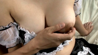 Perverse Japanese young maid Madoka Ayukawa gets big tits massaged on camera