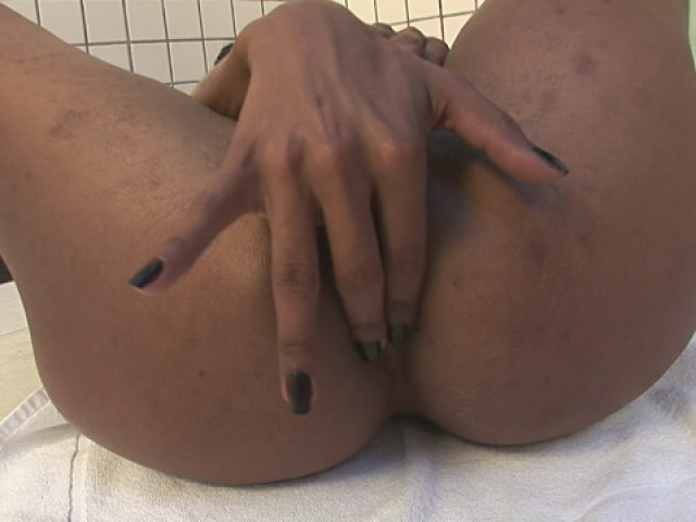Pierced ebony shemale Kawana playing with her gigantic cock