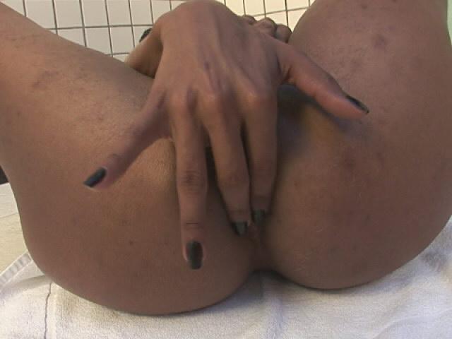 Pierced ebony shemale Kawana playing with her gigantic cock