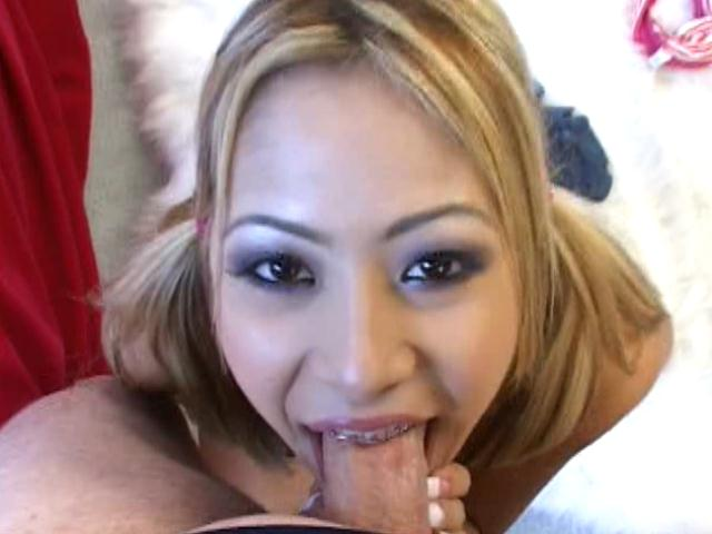 Pigtailed blonde asian cutie Kat sucking a monster cock on her knees in POV style