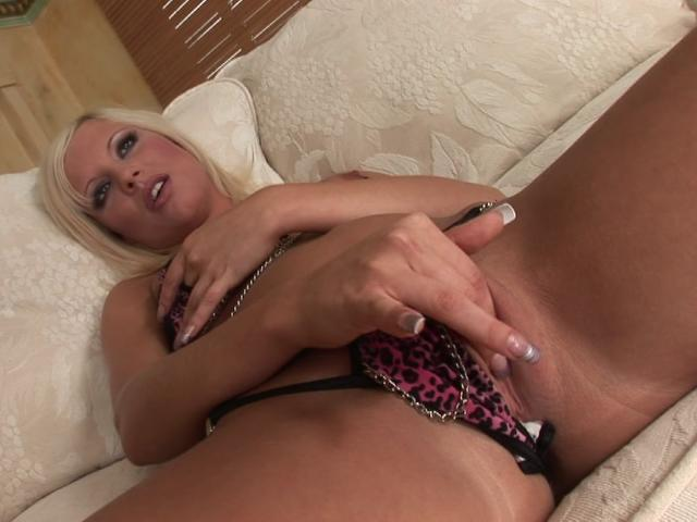Platinum blonde goddess fingering her shaved pussy on the couch