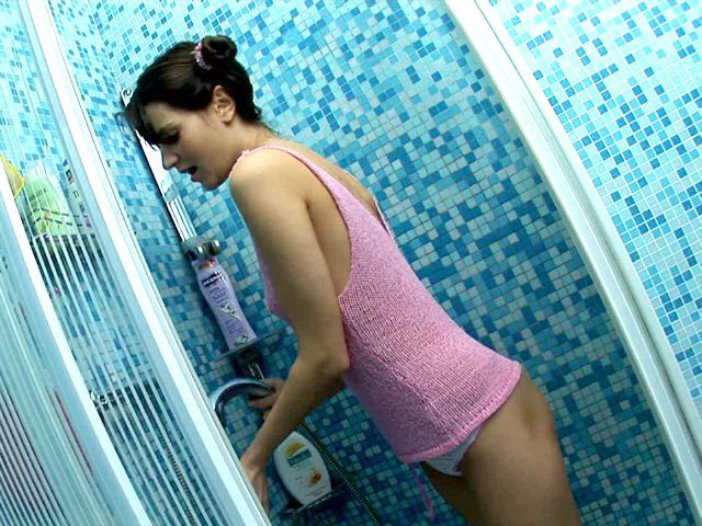 Playful brunette teen angel Lo stripping panties and teasing with her fuckable ass in the shower
