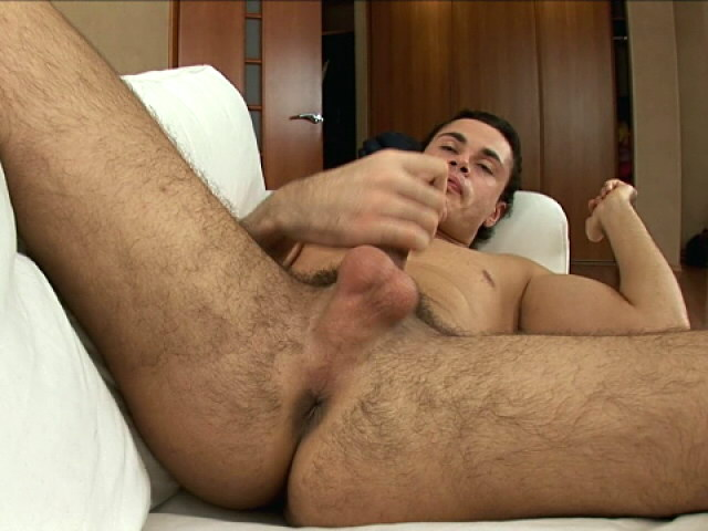 PLeasing brunette euro twink spreading his hairy legs and jerking his big dick