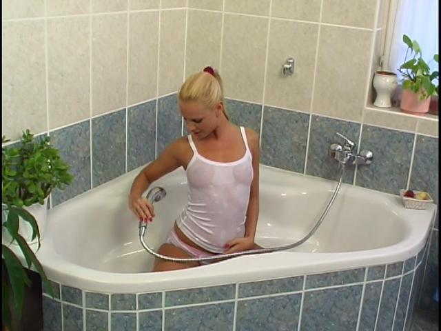 Ponytailed blonde Czech siren washing her perfect booty in the bath tube