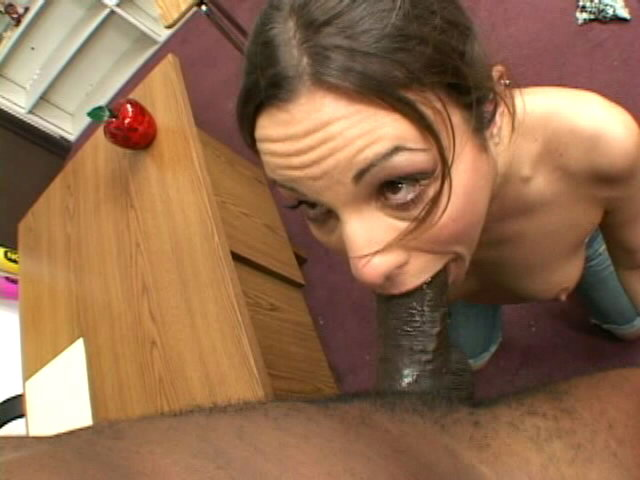 Ponytailed brunette schoolgirl Amber Rayne gives deep throat to a black dude in classroom