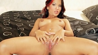 Pretty Redhead Fucking Her Slit with a Dildo