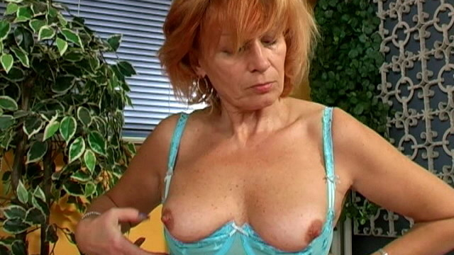 red-haired-busty-granny-in-blue-lingeria-lady-rubbing-her-hairy-muff_01