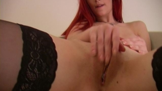 Red haired pornstar in stockings Ariel shows juicy tits and rubs her delicious pussy